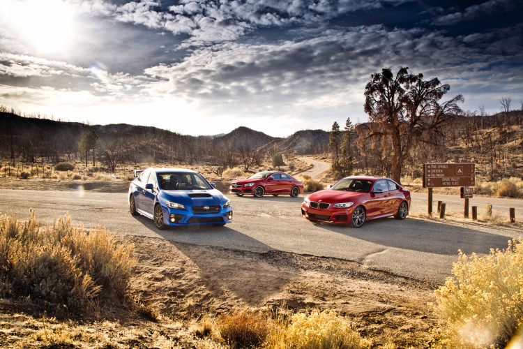 BMW-M235i-vs-Mercedes-Benz-CLA45-AMG-vs-Subaru-WRX-STI-front-three-quarters-750x500