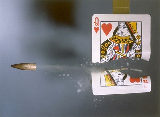 card hit by a .30 calibre bullet, 1970